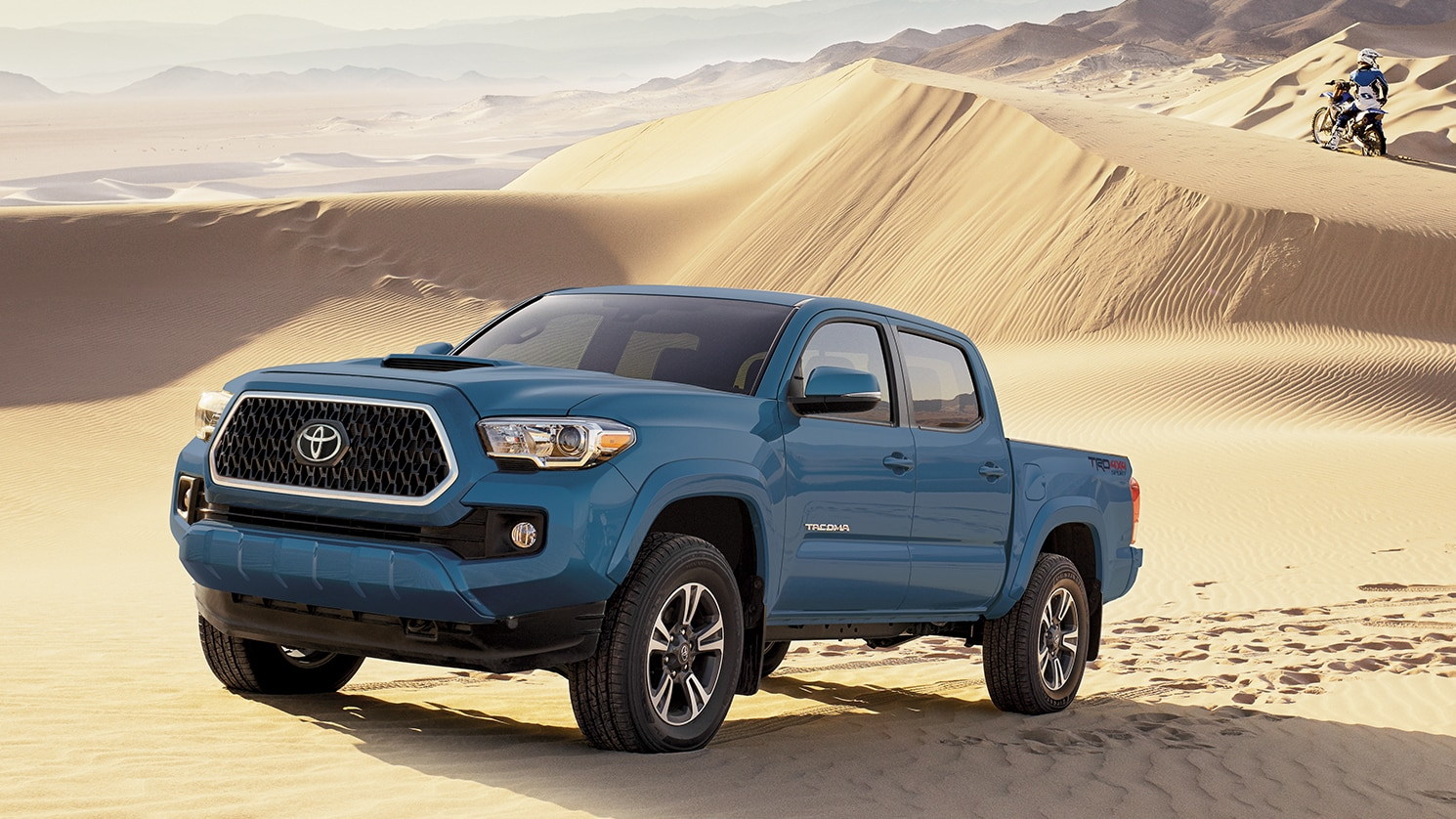 blue tacoma in the desert