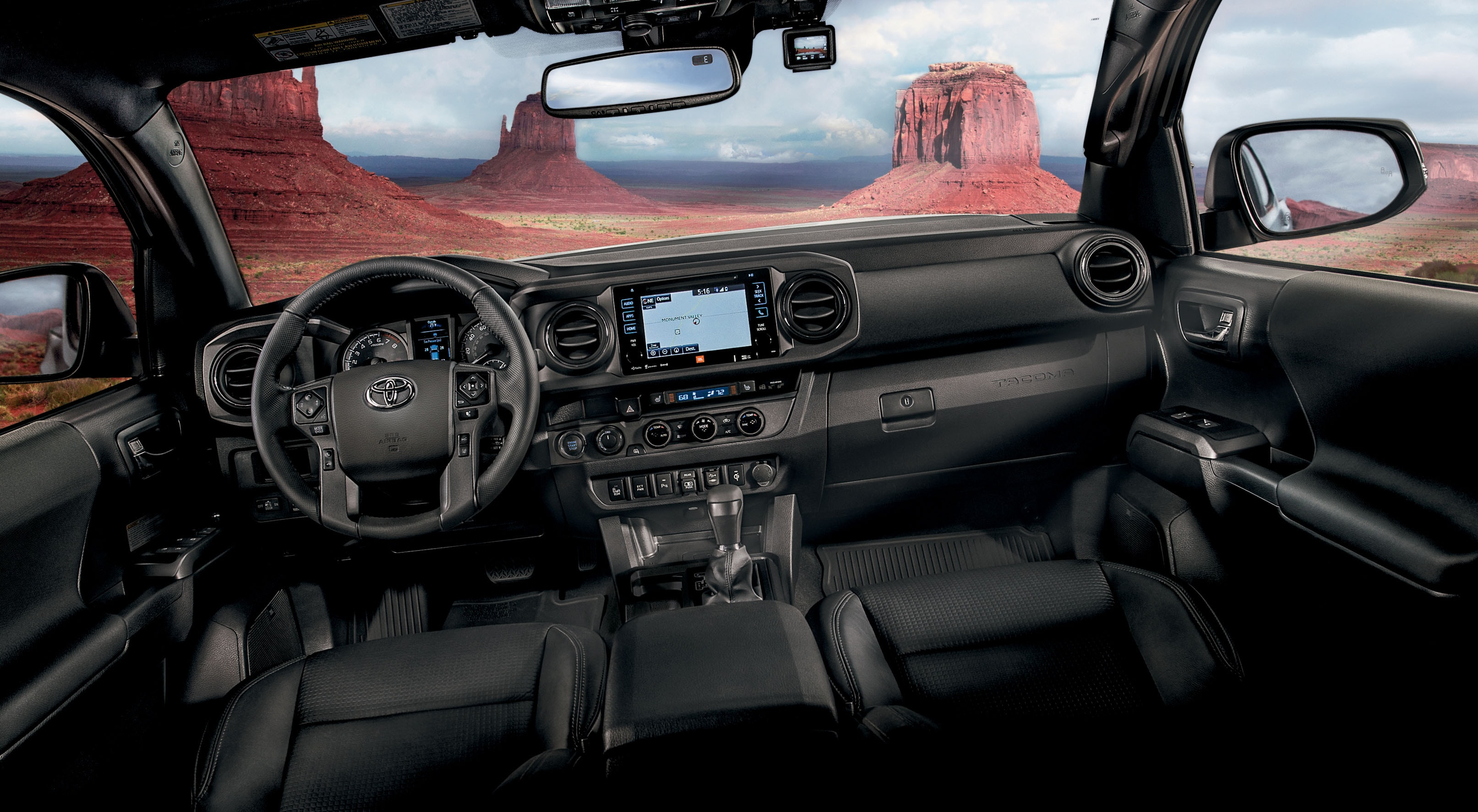 Interior view of the front seat of a 2018 Tacoma