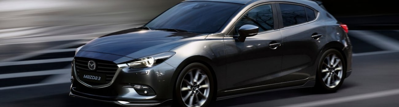 used 2018 Mazda3 hatchback in motion with blurred lines and surroundings