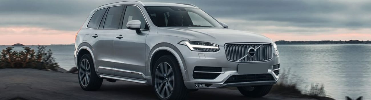 Used 2018 Volvo XC90 SUV silver exterior color shoreline driving