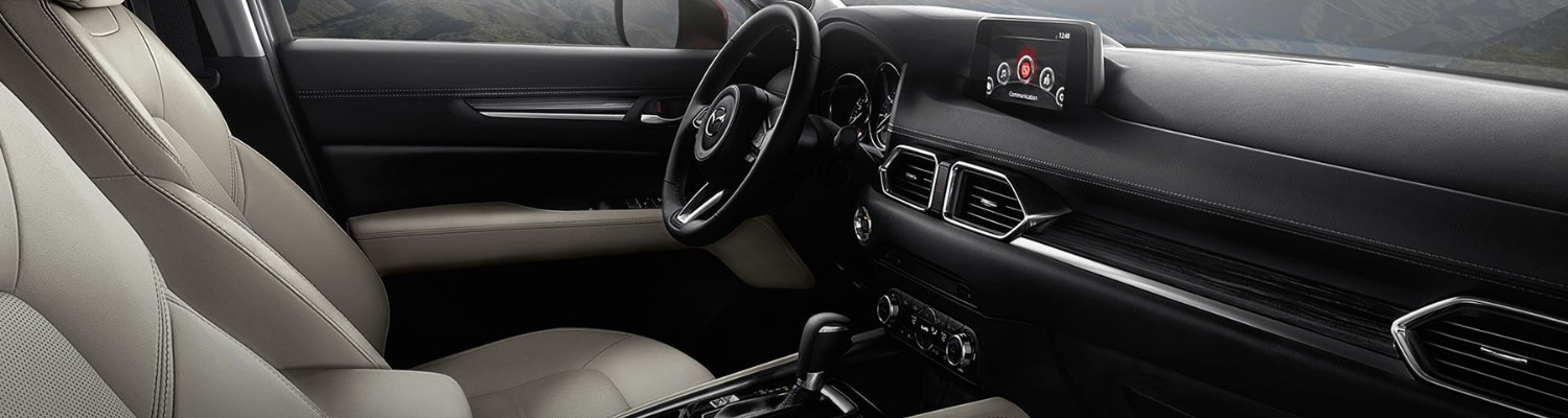 Interior view of a 2018 Mazda CX-5 from the front passenger side door