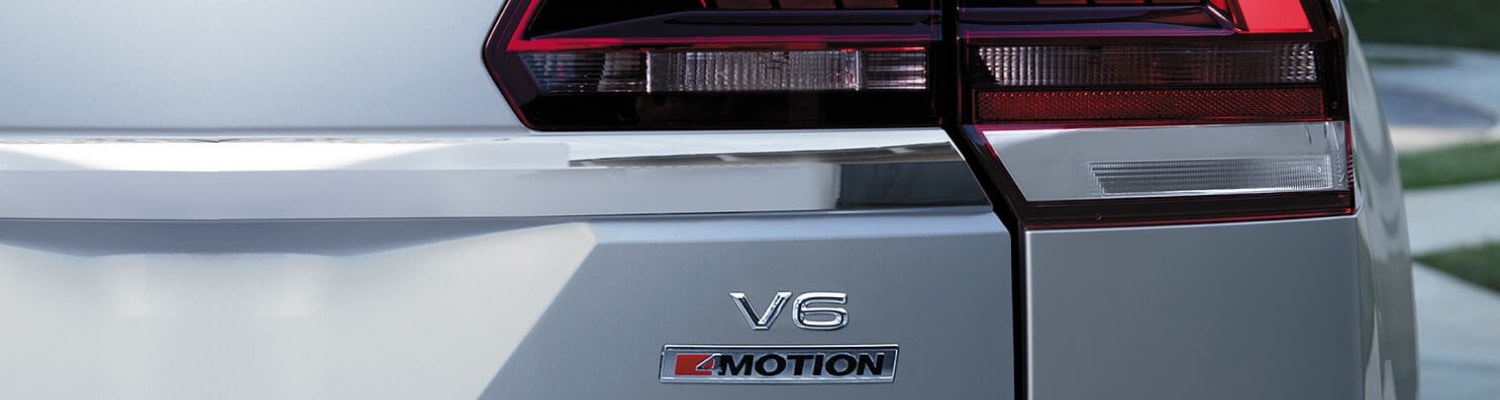 Close up picture of the V6 4MOTION logo on the rear back door of a 2019 VW Atlas