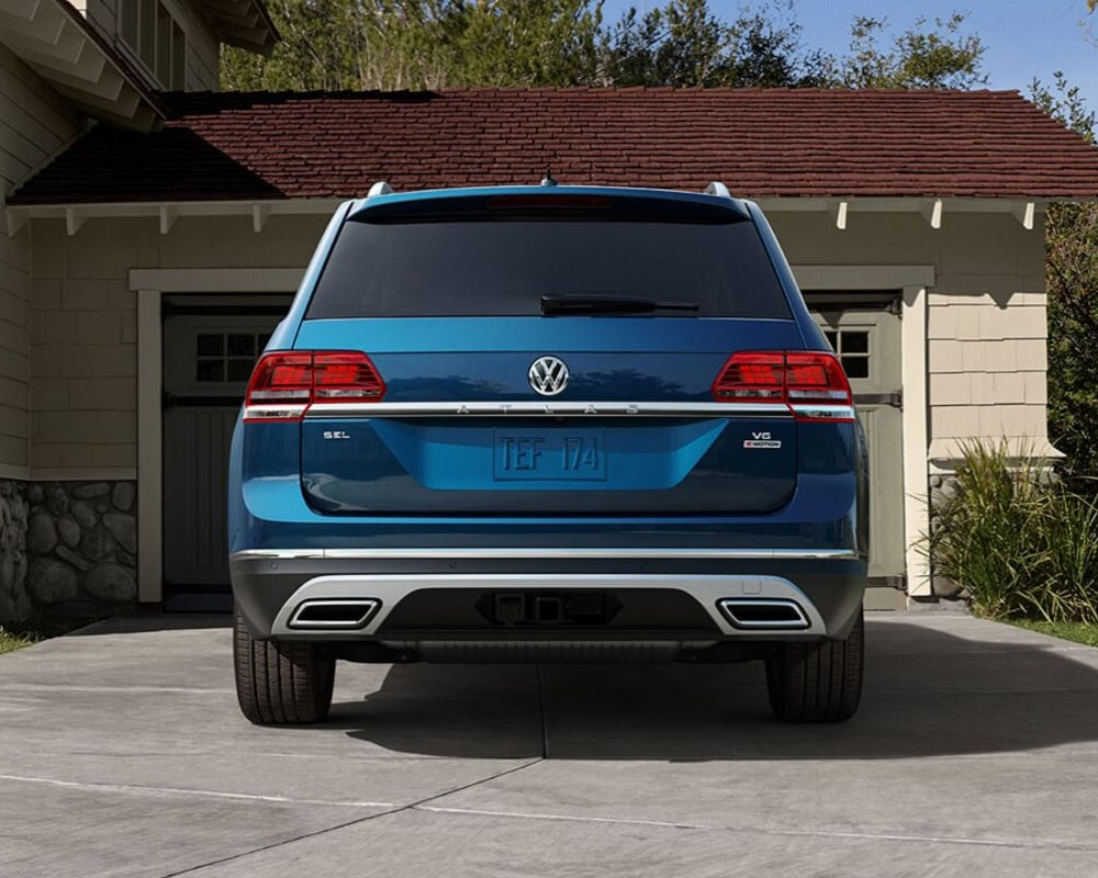 2019 Volkswagen Atlas rear exterior angle blue exterior color parked outside a garage in Colorado Springs