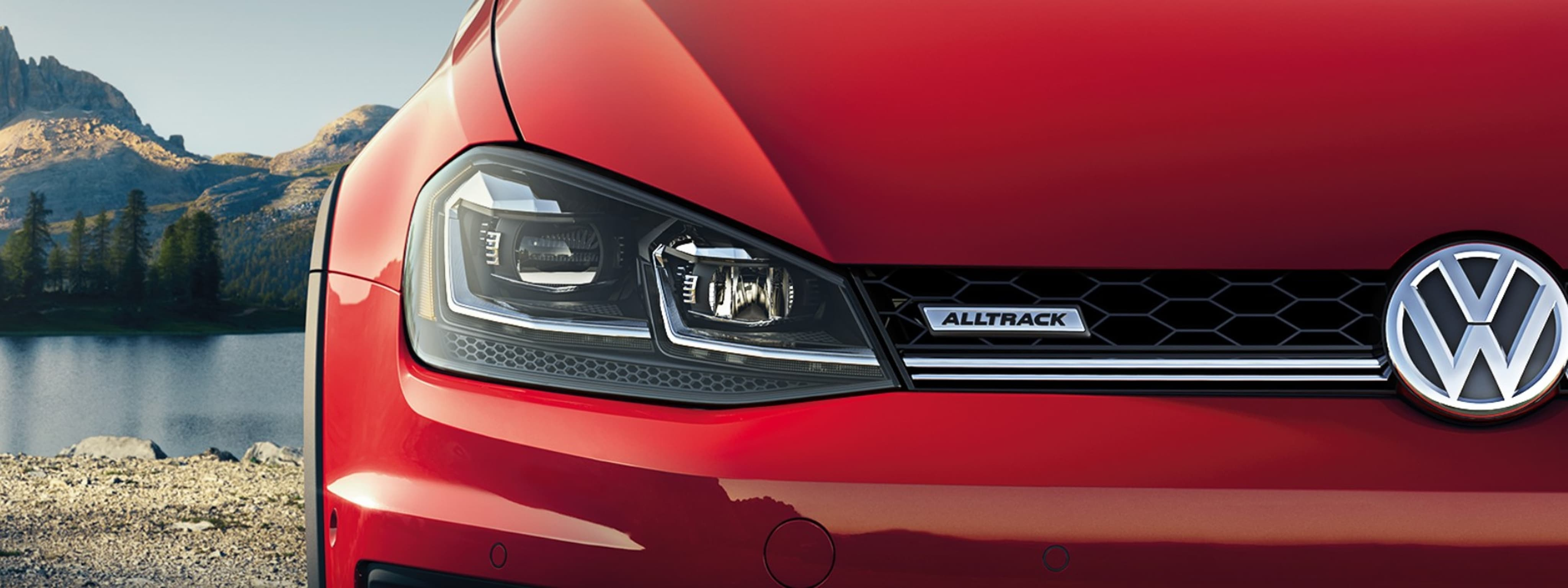 A closeup front view of a tomato red 2019 VW Golf Alltrack