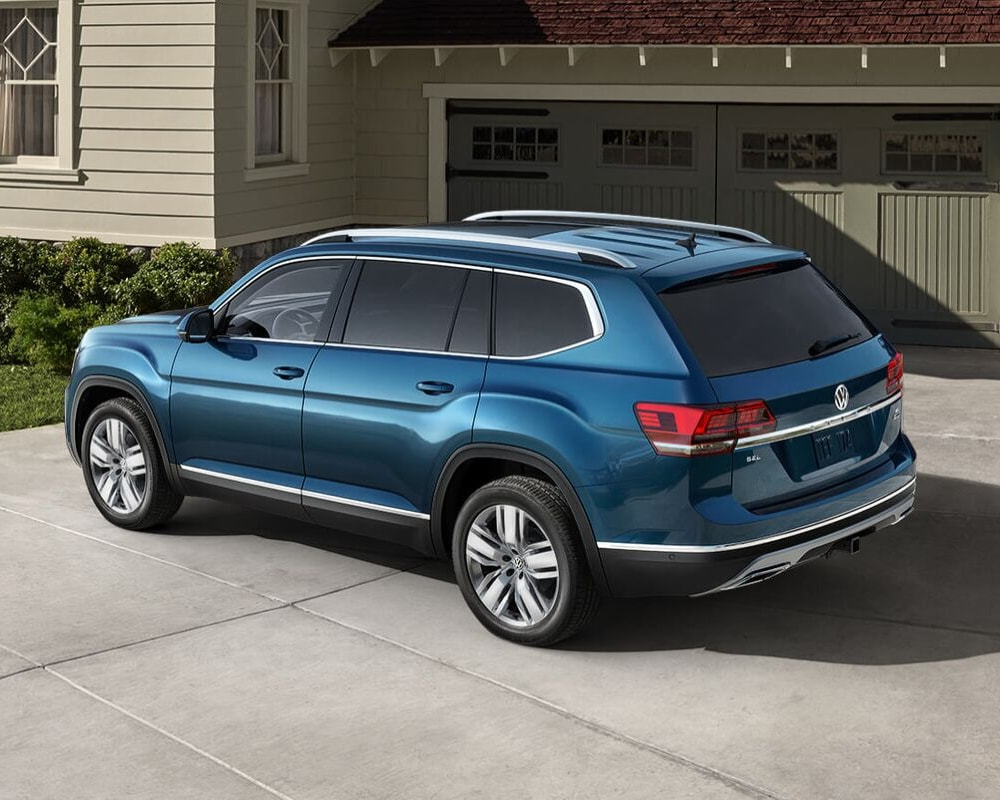 2019 Volkswagen Atlas driver side blue exterior color parked in a driveway