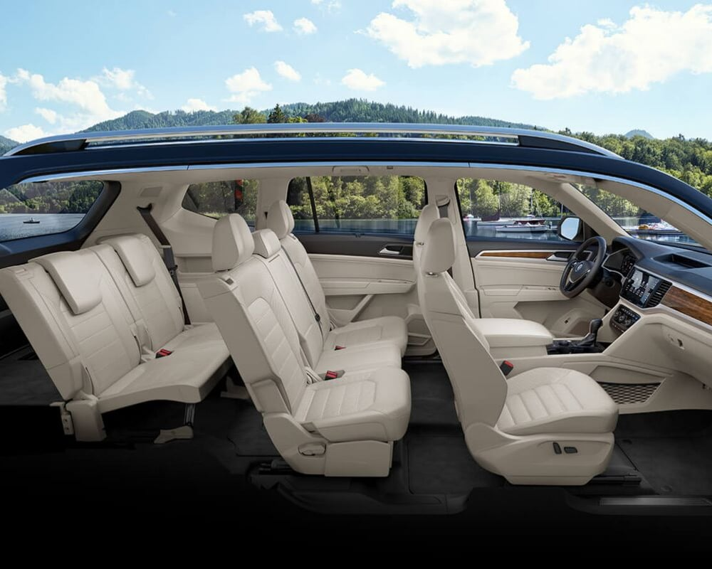 2019 Volkswagen Atlas interior complete view from the passenger side showing each row of seating and front dashboard