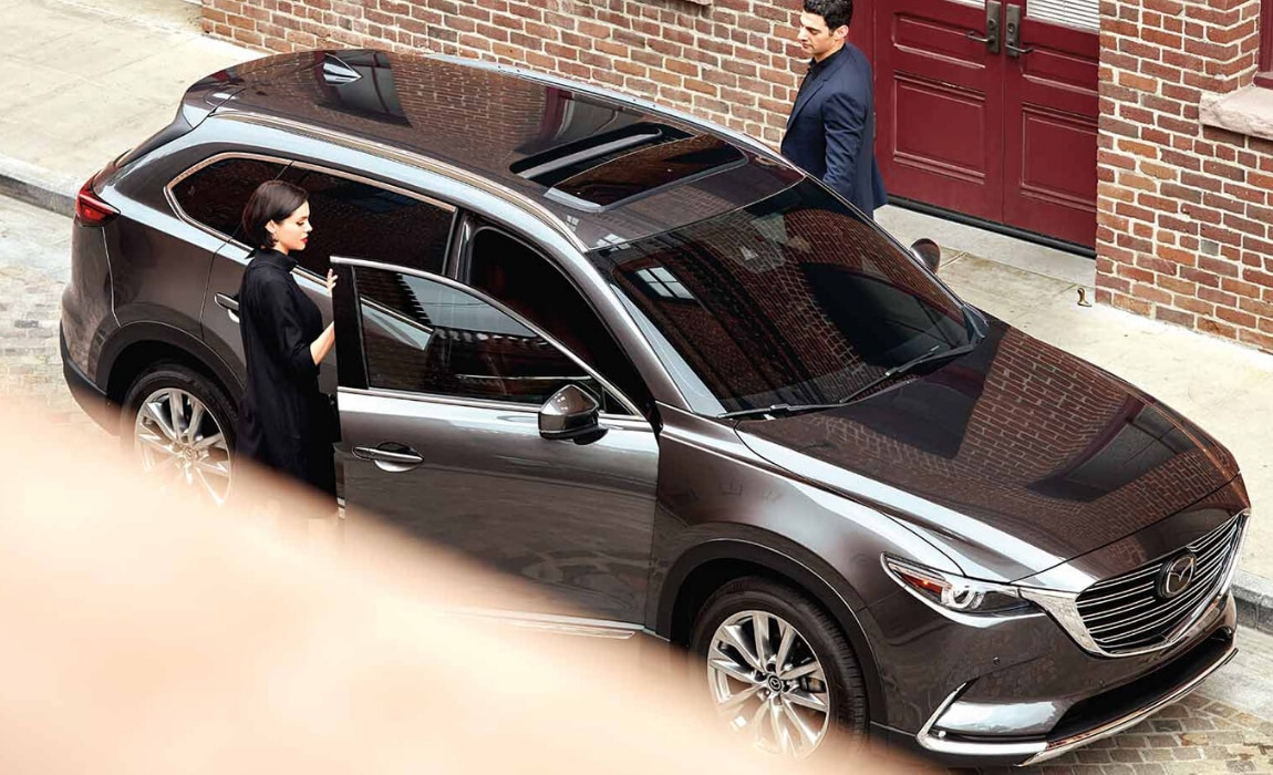 Aerial exterior view of the new Mazda CX-9 in metallic gray