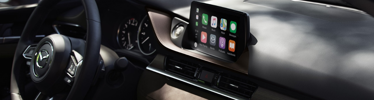 Interior of a 2019 Mazda6 showing Apple Car Play on the touchscreen infotainment system