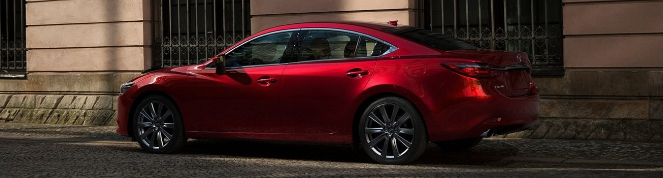 2019 Mazda6 Signature Skyactiv-D exterior red color parked traditional downtown city building