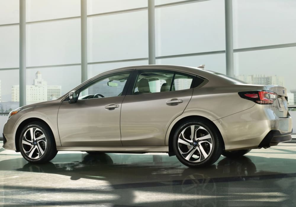 Driver side exterior view of a 2020 Subaru Legacy on a showroom floor