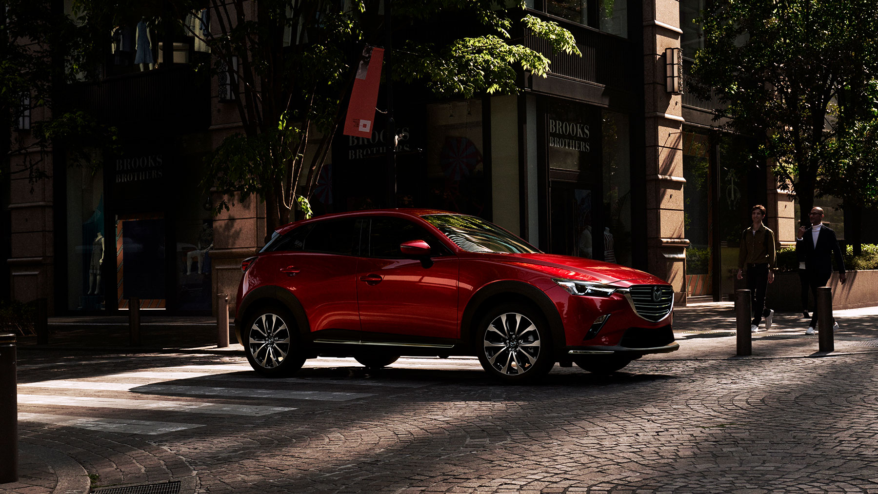 a red 2020 Mazda CX-3 parked in the city