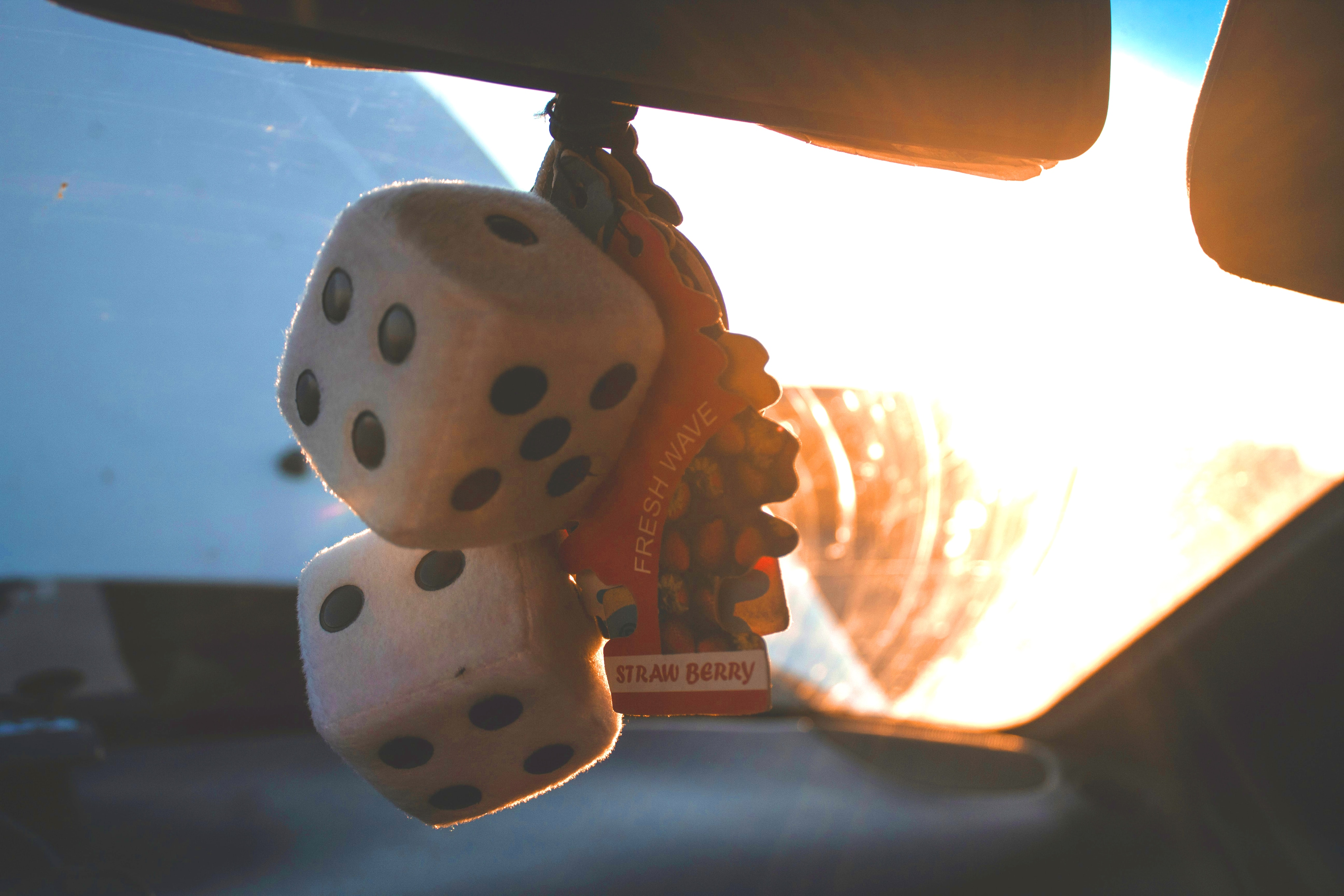 What you can get to personalize your vehicle at Boch Honda, Boch Toyota, Boch Nissan, Boch Hyundai, Boch Chevrolet, Genesis of Norwood, Boch Toyota South, Boch Honda West, Boch Nissan South, & Boch New to You in Massachusetts | Fuzzy dice and car freshener inside vehicle
