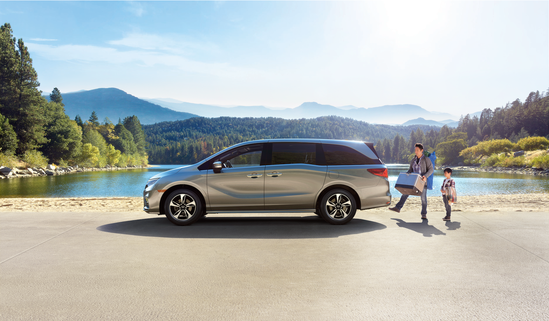 Boch Honda West is a Family Owned Dealership near Groton, MA | Father and child with 2020 Honda Odyssey by lake