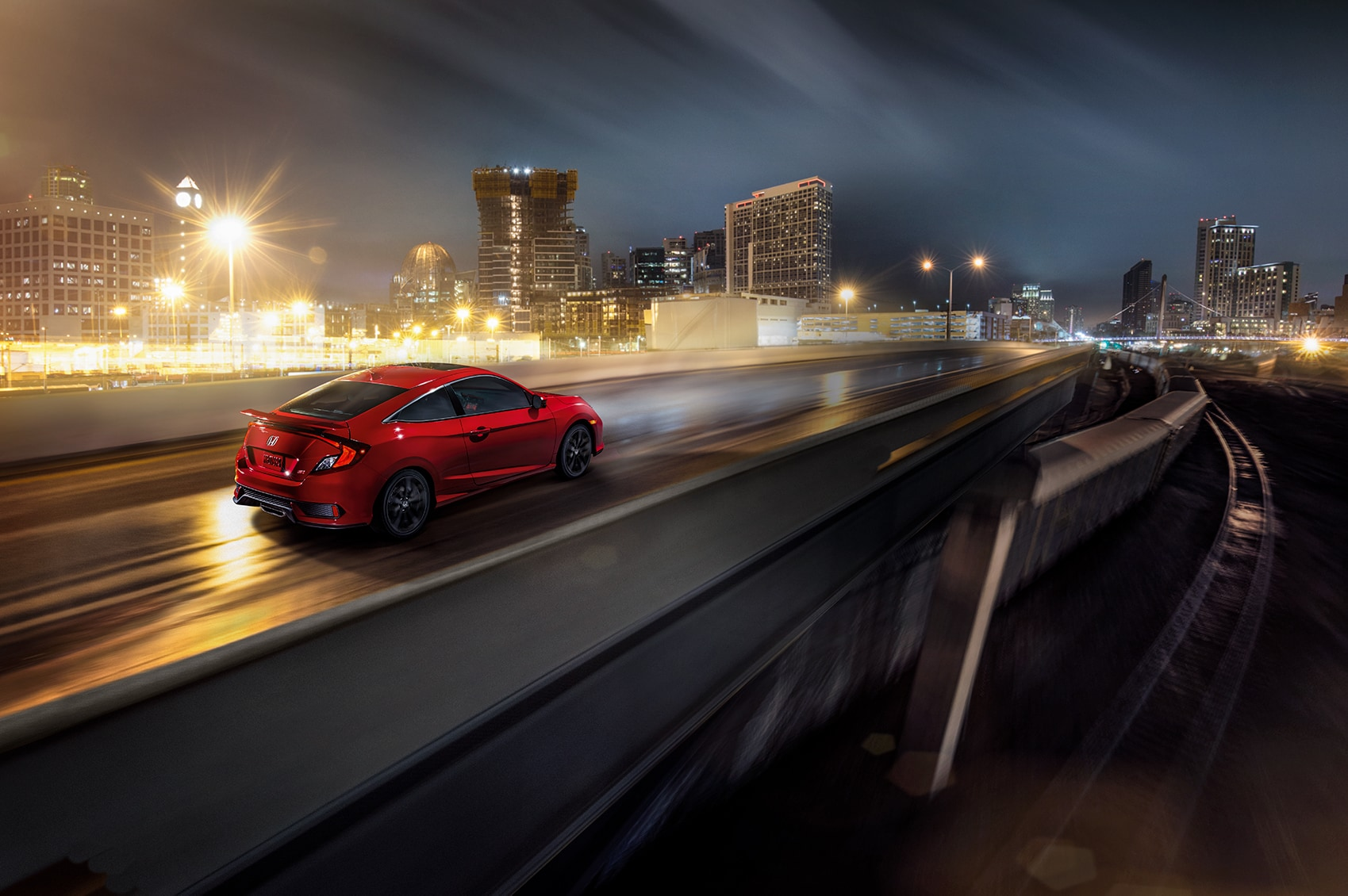 Boch Honda West is a Family Owned Dealership near Boxborough, MA | 2020 Honda Civic driving on highway at night