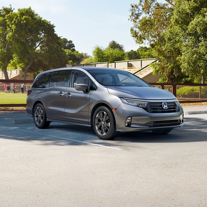 Boch Honda West is a Family Owned Dealership near Acton, MA | Silver 2020 Odyssey Parked Next to Soccer Field