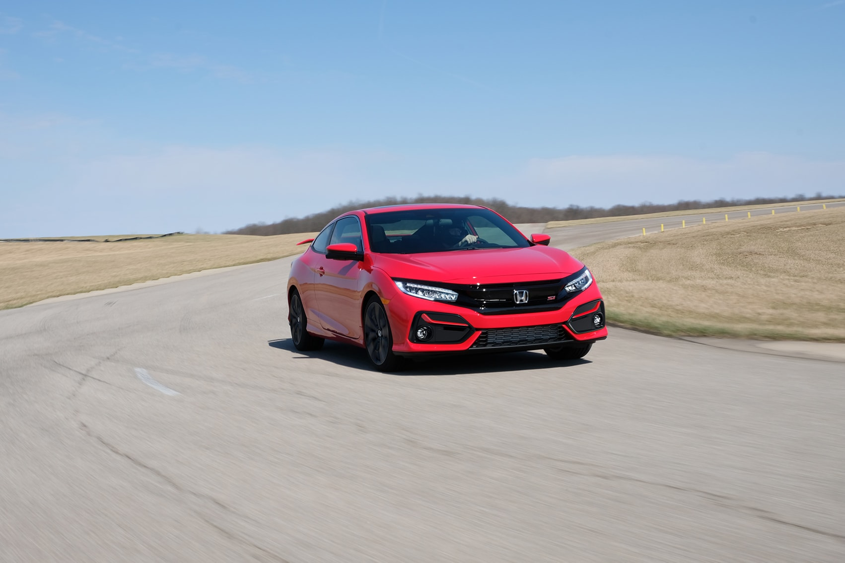Boch Honda West is a Family Owned Dealership near Chelmsford, MA | Red 2020 Honda Civic on the track