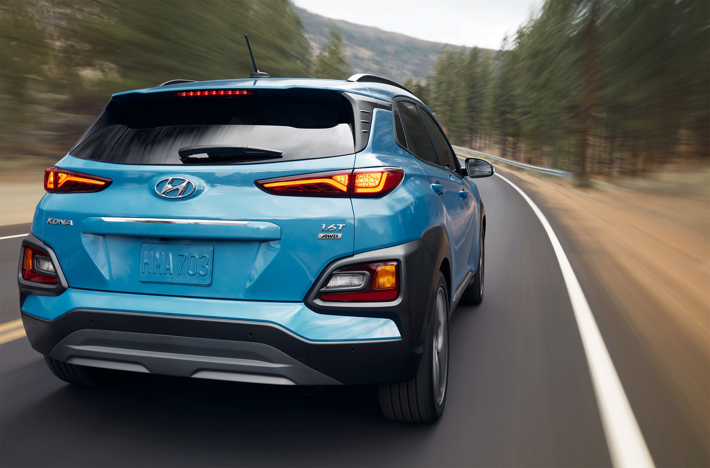 what different tire options are available at Boch Hyundai in Norwood | Blue hyundai kona running on road