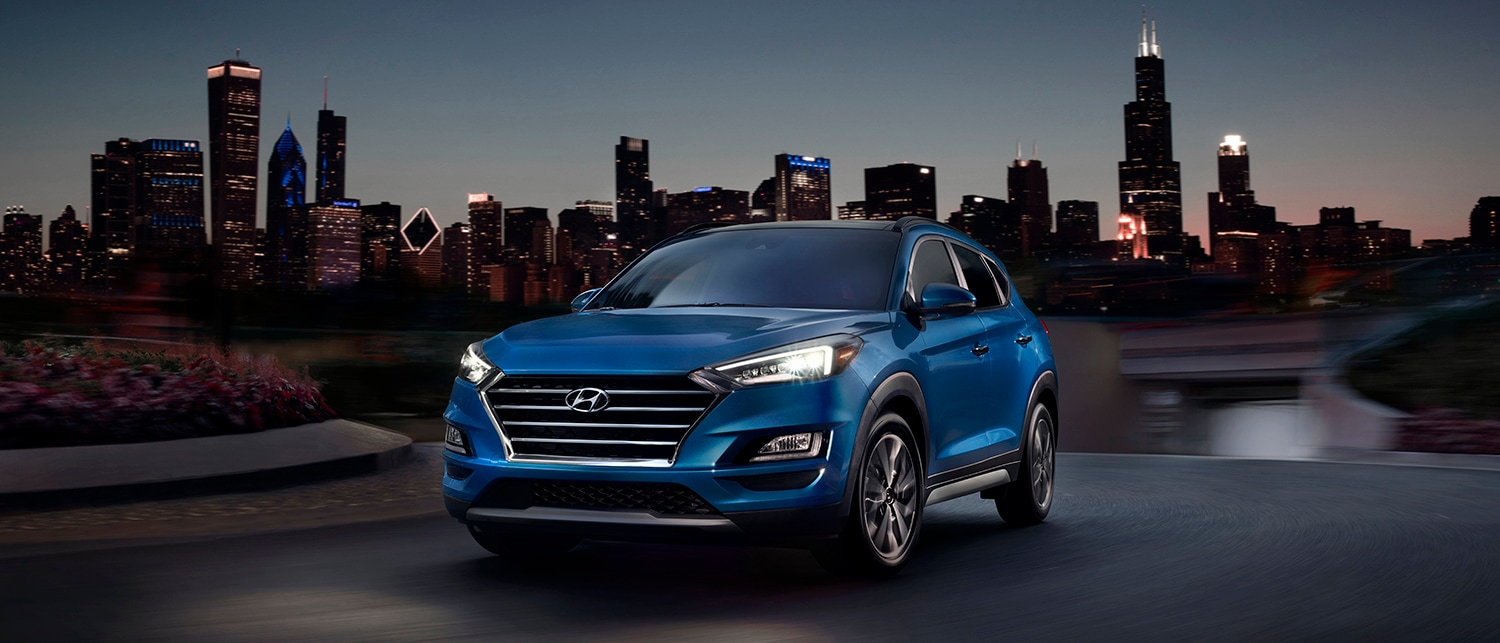 what different tire options are available at Boch Hyundai in Norwood | Blue hyundai tucson parked on road