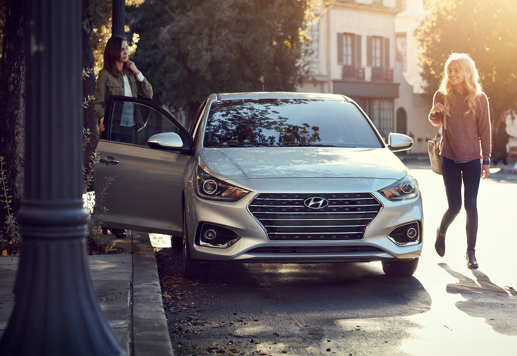 Woman opening door of the hyundai