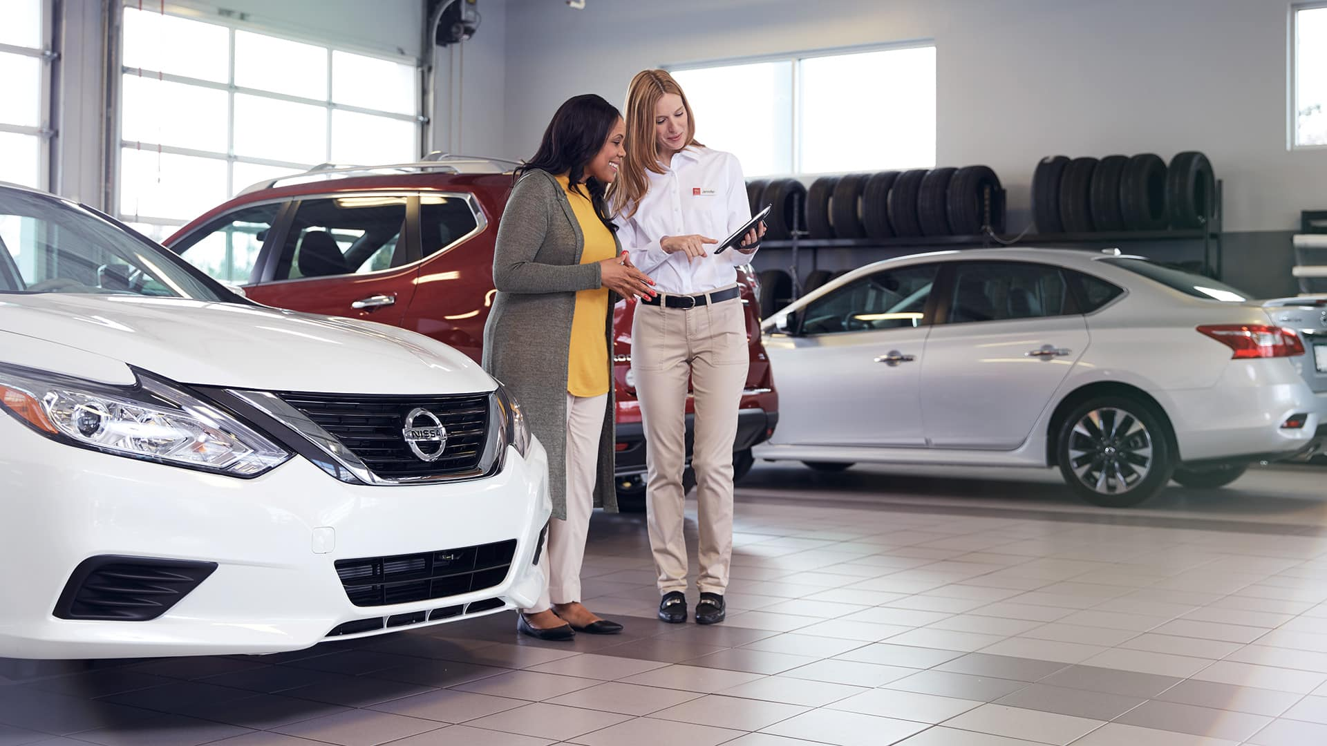 Boch Nissan South is a Family Owned Dealership near Pawtucket, RI | Customer meeting with Nissan Service Advisor