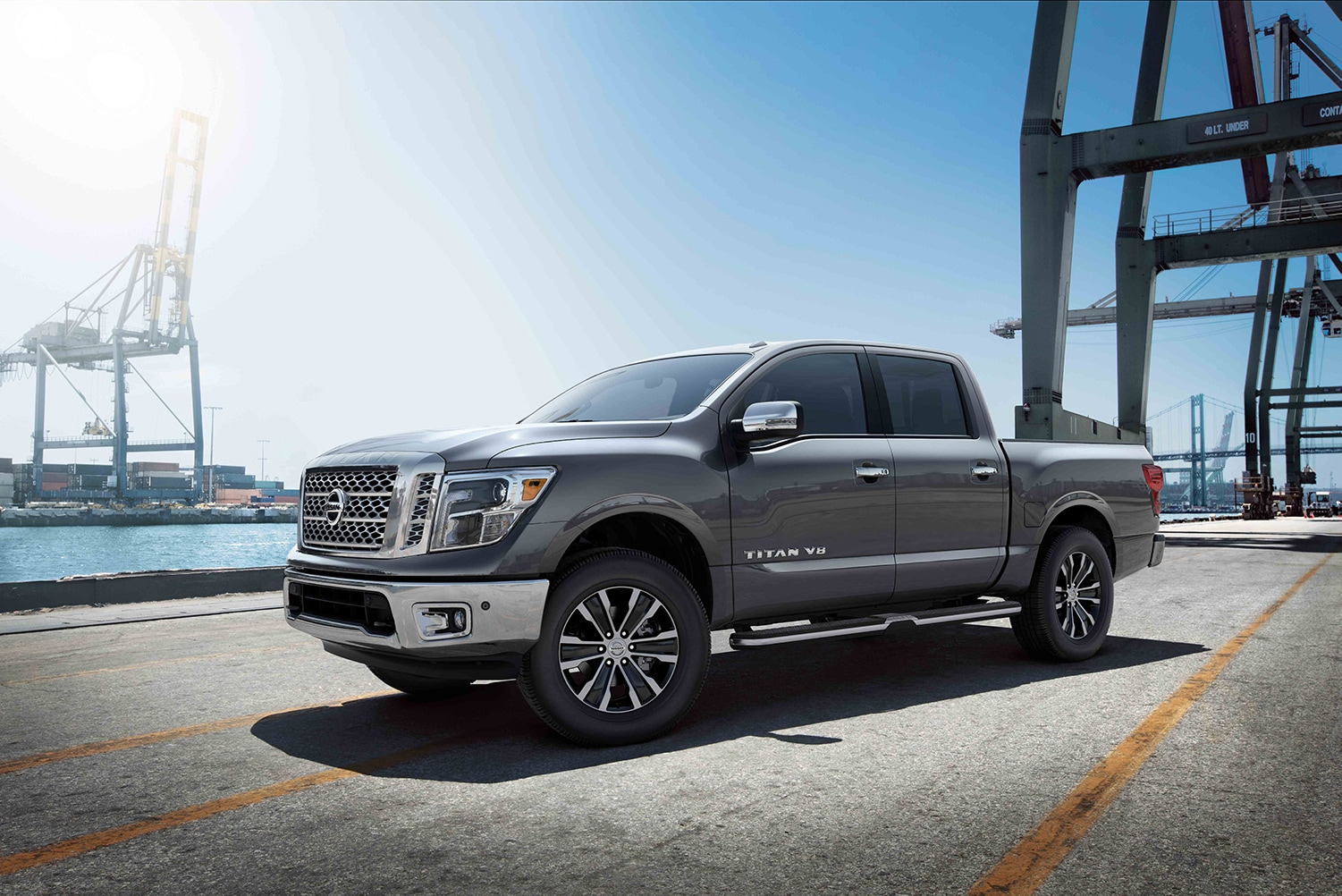 Boch Nissan South is a Family Owned Dealership near Pawtucket, RI | Gray 2020 Nissan Titan parked by harbor