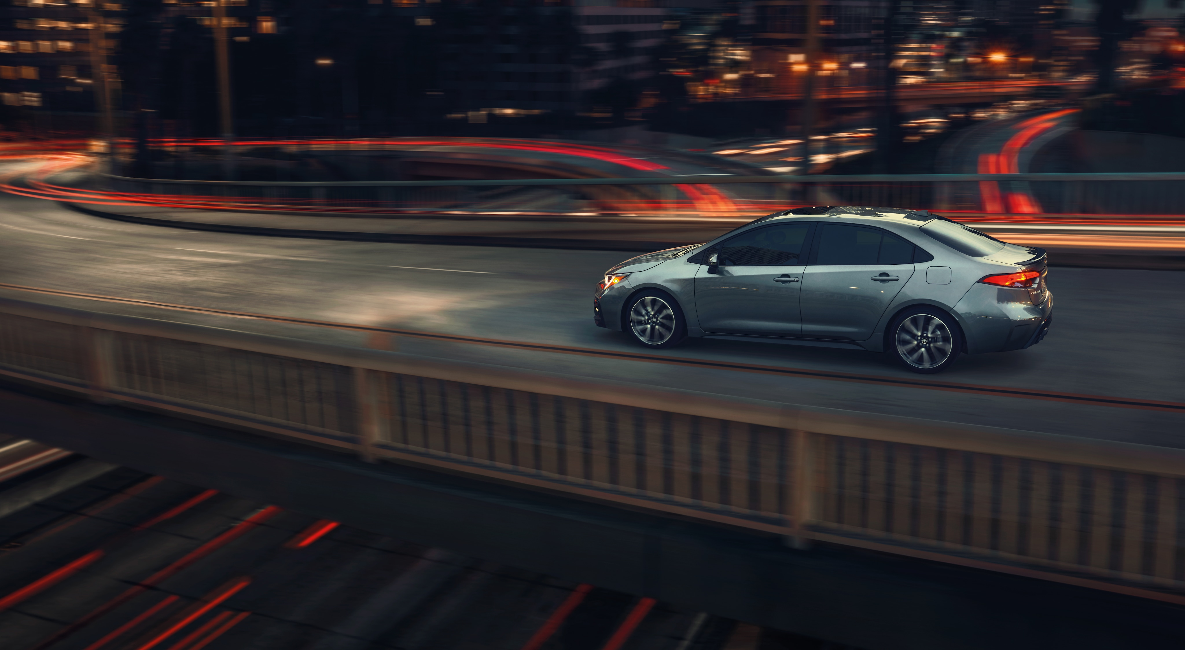 Boch Toyota is a Family Owned Dealership near Boston, MA | 2020 Toyota Corolla driving on city skyway at night