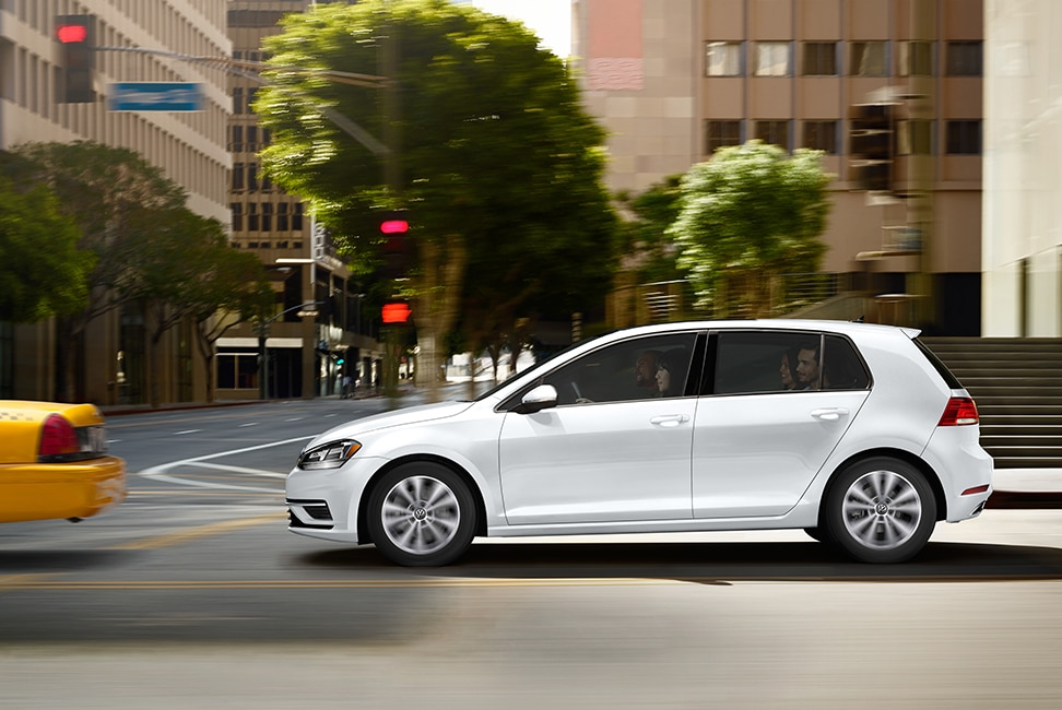 2020 Volkswagen Golf driving through intersection