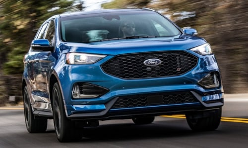2020 Ford Edge ST in motion forest highway