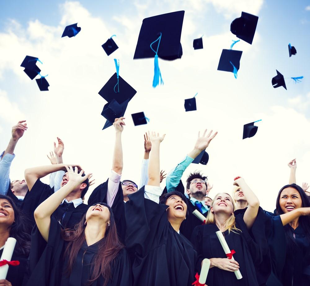 College Grads Throwing Caps