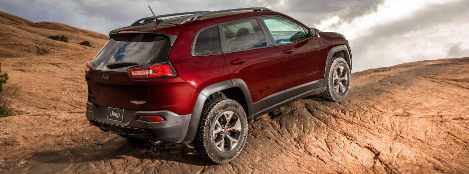 Red 2018 Jeep Cherokee ascending a rocky hill