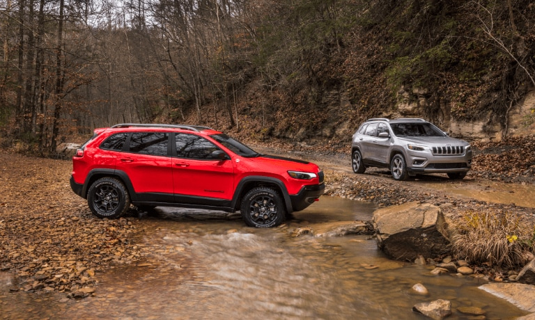 2021 Red & Grey Jeep Cherokee Parked in mud