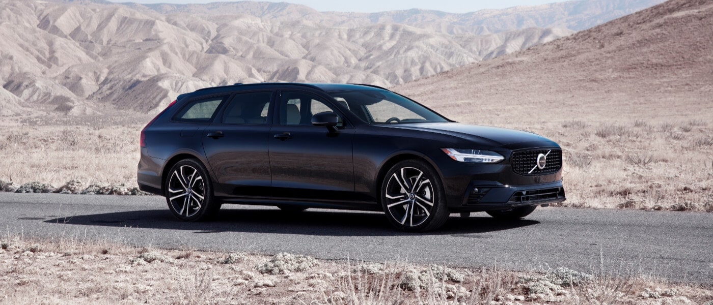 2021 Volvo V90 driving through a desert