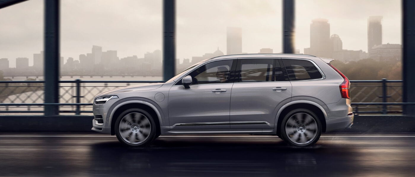 2021 Volvo XC90 driving on a bridge side exterior
