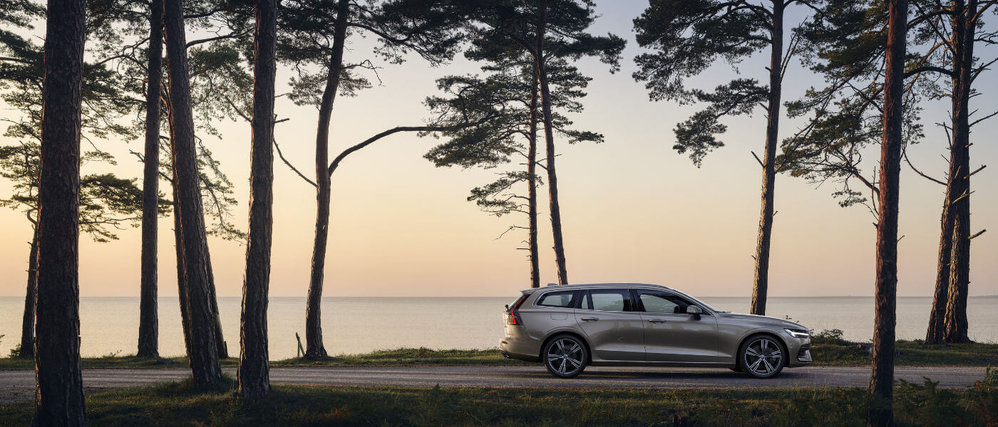 Volvo V60 side profile view driving by water