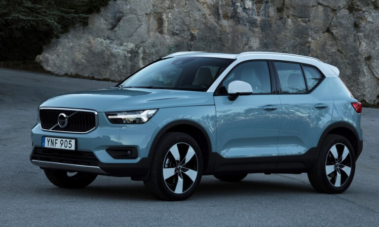 New Volvo XC40 parked by a rock