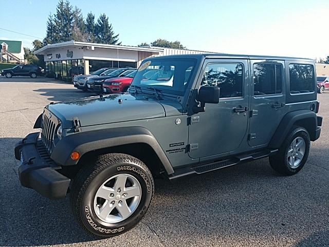 Featured Pre-Owned 2015 Jeep Wrangler Unlimited Sport SUV for sale in Rutland, VT at Brileya's Chrysler Jeep