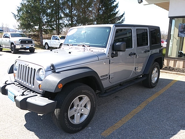 Featured Pre-Owned 2013 Jeep Wrangler Unlimited Sport SUV for sale in Rutland, VT at Brileya's Chrysler Jeep