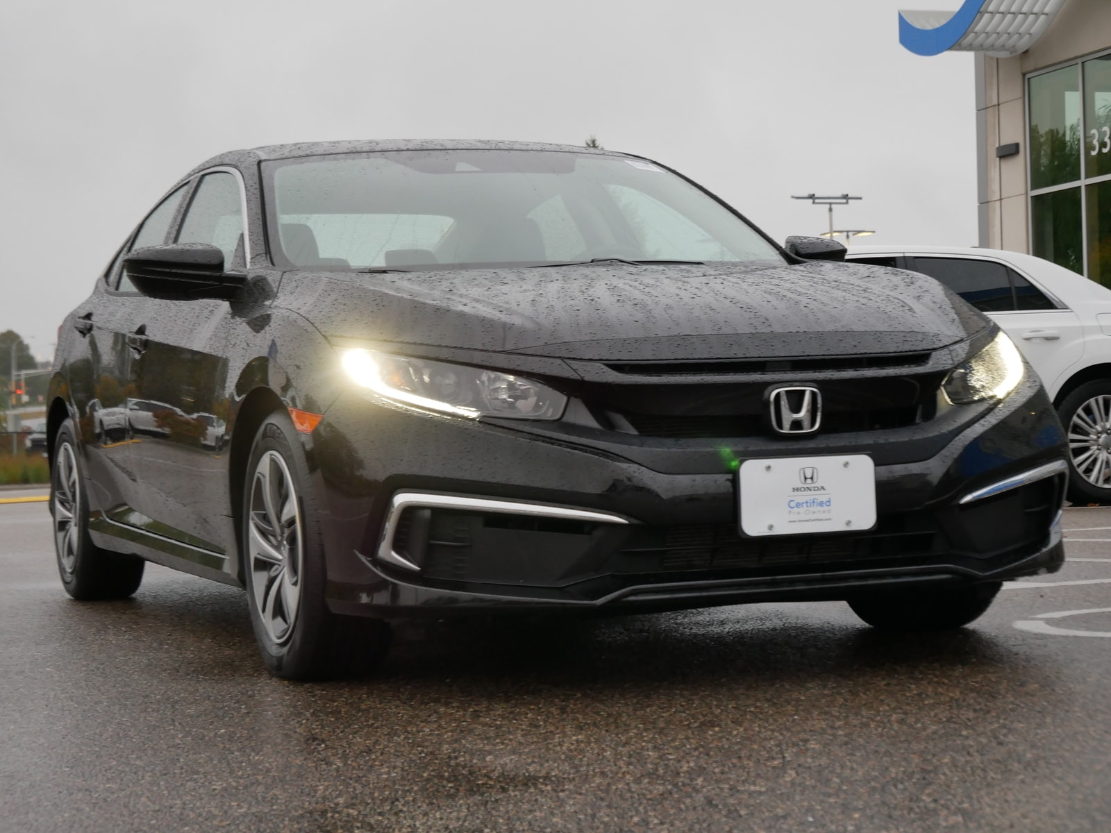 Certified 2019 Honda Civic LX with VIN 19XFC2F61KE011849 for sale in Saint Paul, Minnesota