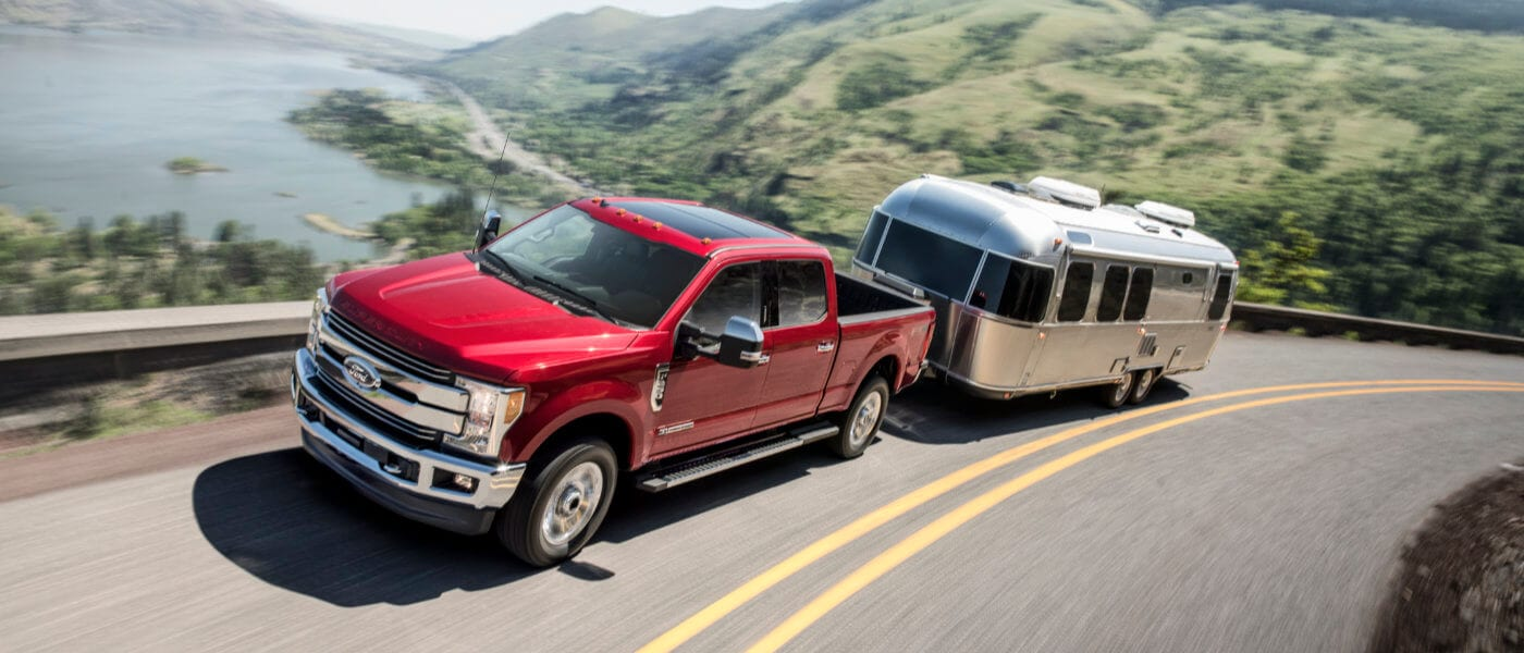 2019 Red Ford F-250 Towing a Trailer