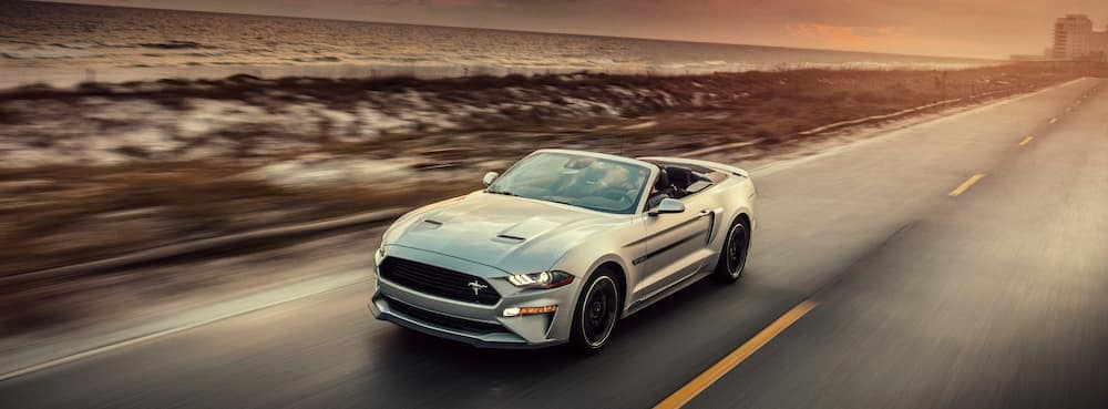 2019 Silver Ford Mustang Driving at Sunset in the Desert