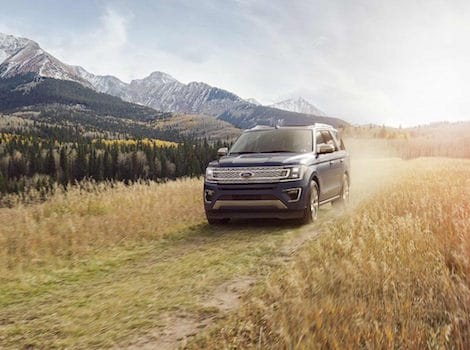 A 2018 Ford Expedition driving through a dirt road