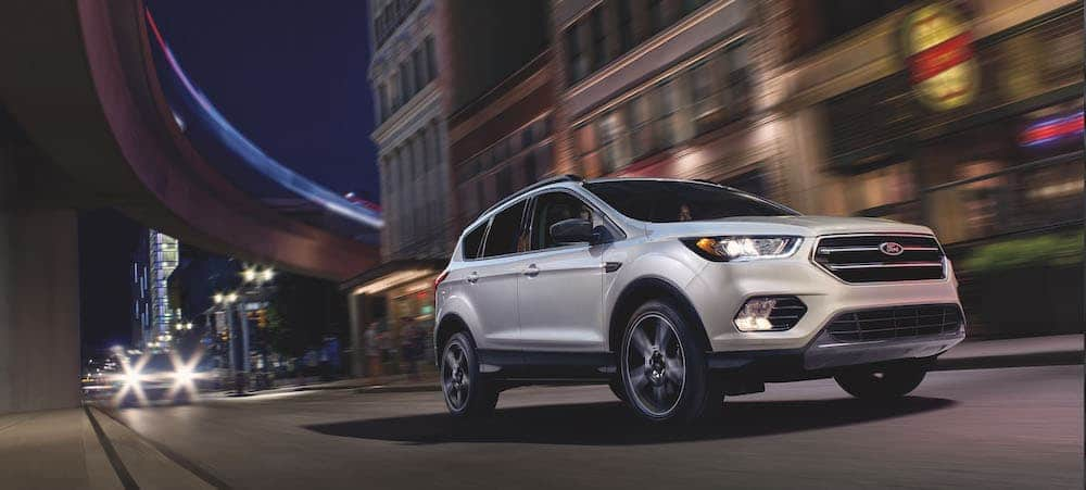 2019 White Ford Escape Driving at Night