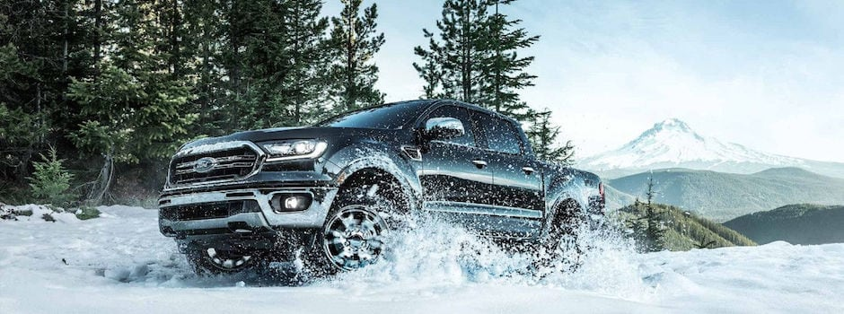 A 2019 Ford Ranger driving through the snow