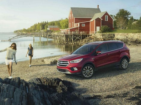 A red 2018 Ford Escape parked by the lake