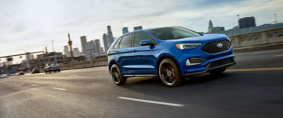 2019 Blue Ford Edge Driving Over a Bridge