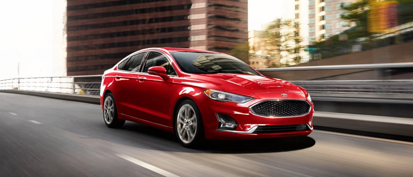 2020 Red Ford Fusion Driving