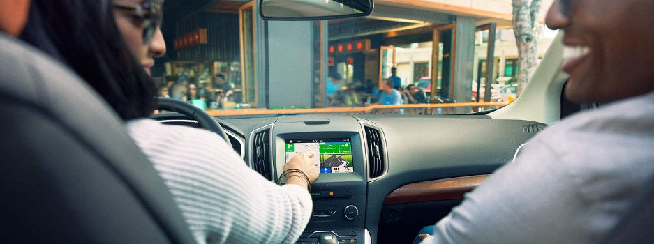 A couple using their SYNC Infotainment System
