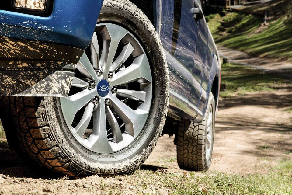 Close up of a mud splattered wheel of a 2018 Ford F-150 STX