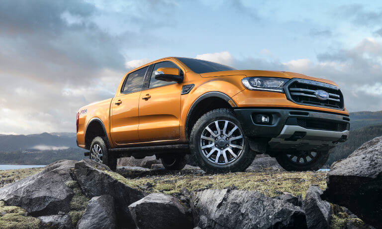 2019 Orange Ford Ranger Parked on a Rock