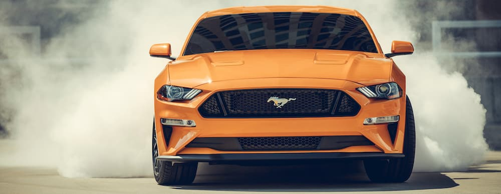 2019 Orange Ford Mustang Doing A Burnout